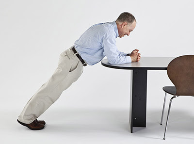 Front Plank on Desk: Place your hands, forearm and elbows down on a desk or table. Shift your feet back to a comfortable plant position. Hold for as long as comfortable to strengthen your core muscles.