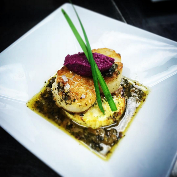 Scallop meunière served over a cauliflower custard and finished with a roasted beet tapenade