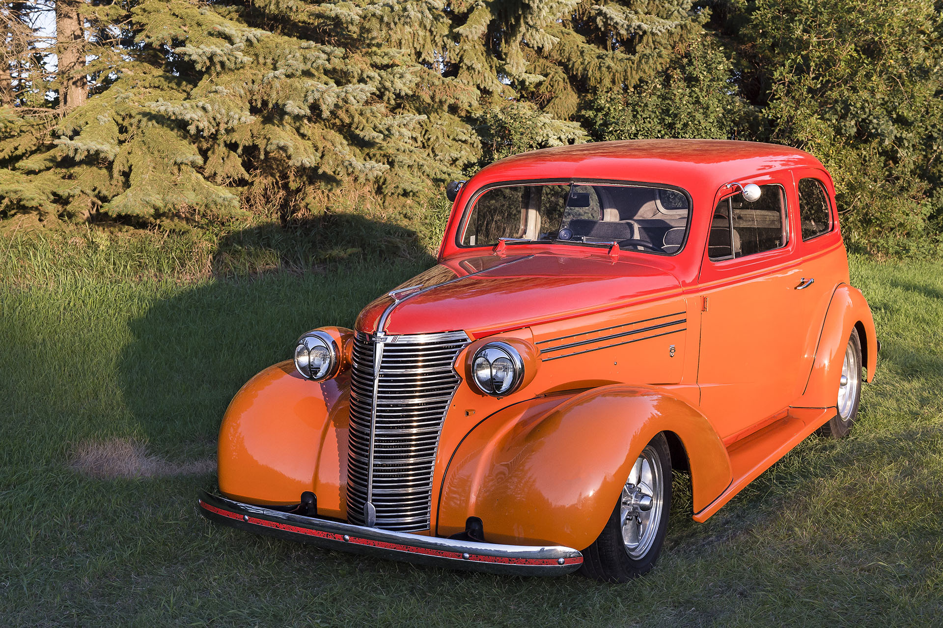 """1938 – Chevy Master Sedan - """" C Plus"""" -    Powered by a 350/290 hp GM performance Crate Engine. Originally built in Regina at the GM Assembly Plant purchased in Regina, Usually seen pulling a 1973 Boler Matching Trailer with Matching Mini Bike attached. Travelled as far as Spokane and Northwest States with the entire family. You can see this vehicle and others at regular Just Kruzin events"""