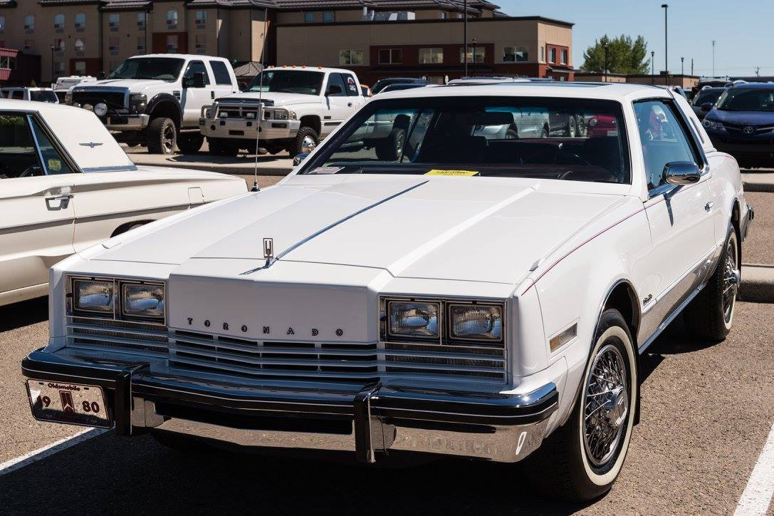 1980 Oldsmobile Brougham, 2 dr Coupe.                                                                                  Engine-350 cid-4 barrel / GM V8 ( #'S MATCHING).  Trans - 3 speed GM Automatic ( ORIGINAL ).  71,280 Kilometers ( ODOMETER READING) ( ORIGINAL ).  Color - Pearl White.  Roof - Factory 1/2 white Landau Vinyl Roof & Factory Sun Roof.  Vehicle Age - 37 Years Old.   Interior: Factory original GM / Oldsmobile front split bench seat - Burgundy Cloth / Velour.  Factory original GM 350 cid V8. ( NON - REBUILT ).  Frame - Factory original GM frame - Highly detailed.
