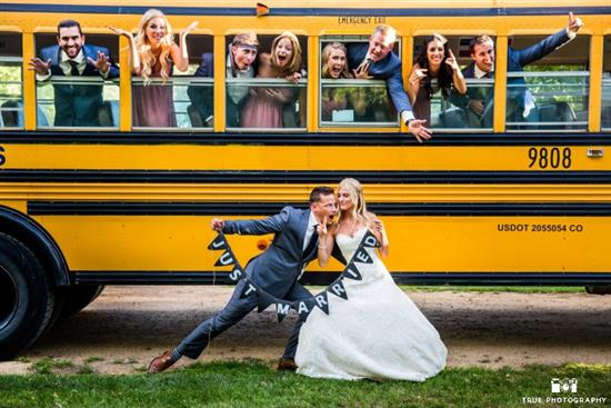 Bridal party with a school bus