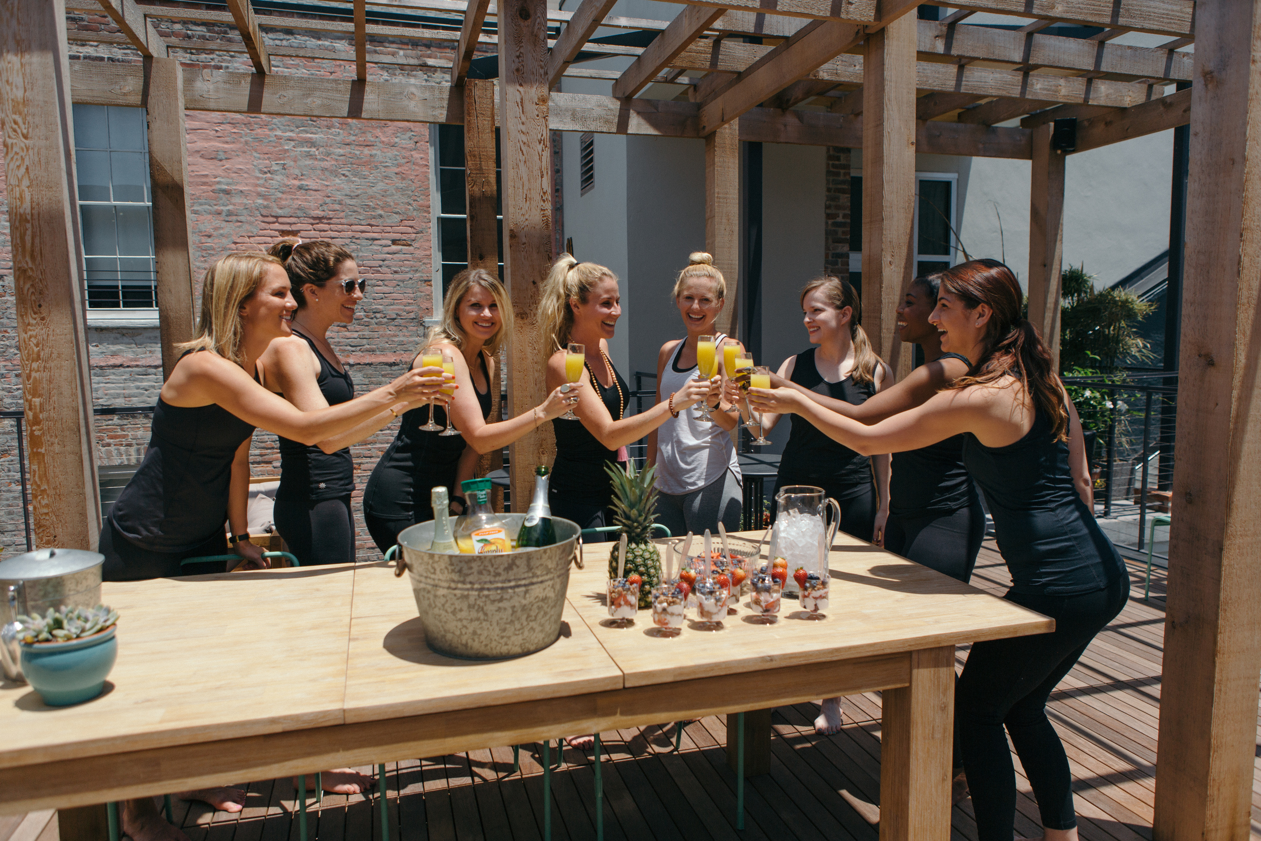 Bride Tribe Yoga Bachelorette Party Yoga Brunch Group Cheers.jpg