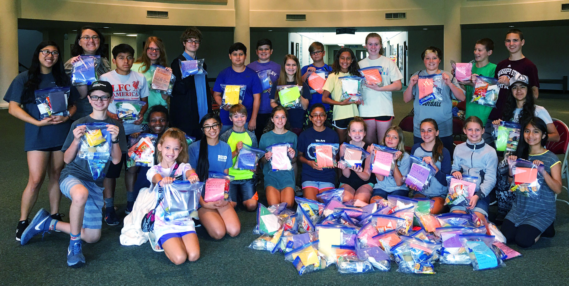 """Youth Week Mission Day - On Tuesday our Crossfire Youth put together """"Manna Bags"""" for people in need. These bags are filled with non-perishable items. Stop by the youth table on Sunday to grab a bag or two to keep in you car for that person who will need it the most!"""