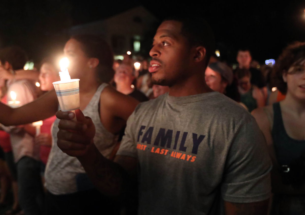 Thousands of UVA students, faculty and Charlottesville residence led a candle light march across grounds Wednesday night, Aug. 16, in Charlottesville, Va. Photo/Andrew Shurtleff/The Daily Progress