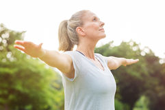 mature-woman-yoga-exercise-doing-park-looking-away-senior-blonde-enjoying-nature-breathing-portrait-89569903.jpg