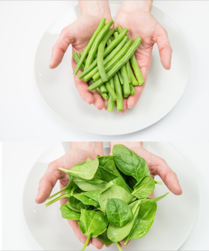 hand portions green vegetables