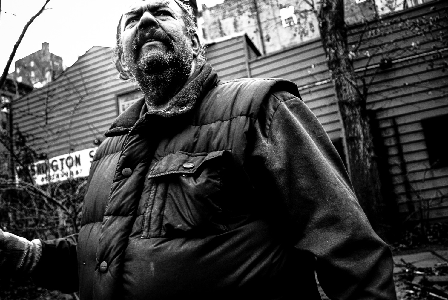 As far as I can tell, this was my first sneak shot.  A friendly gardener near Washington Square Park in Manhattan.  He was kind enough to compliment us for our kids' behavior. Circa '07