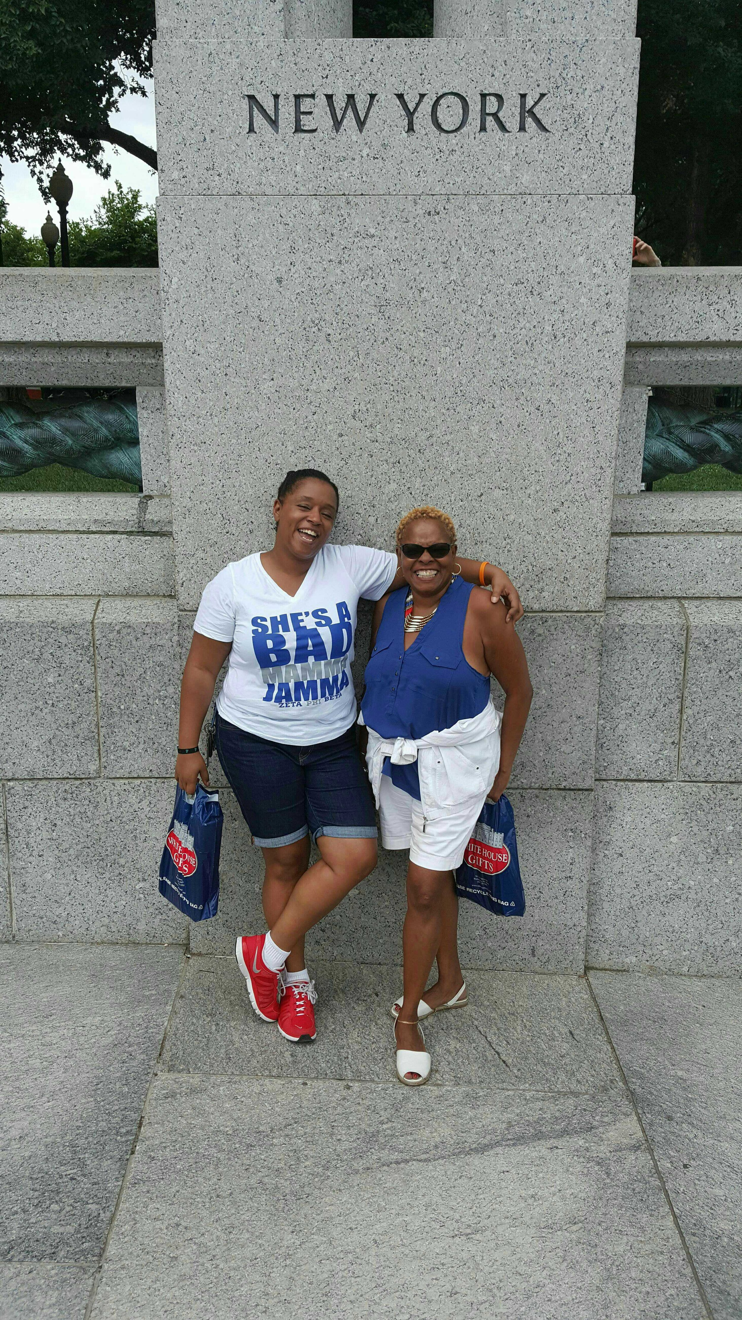 Me and my Mom standing under our home state in DC while doing a tour