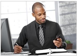 Man-desk-computer-phone.jpg
