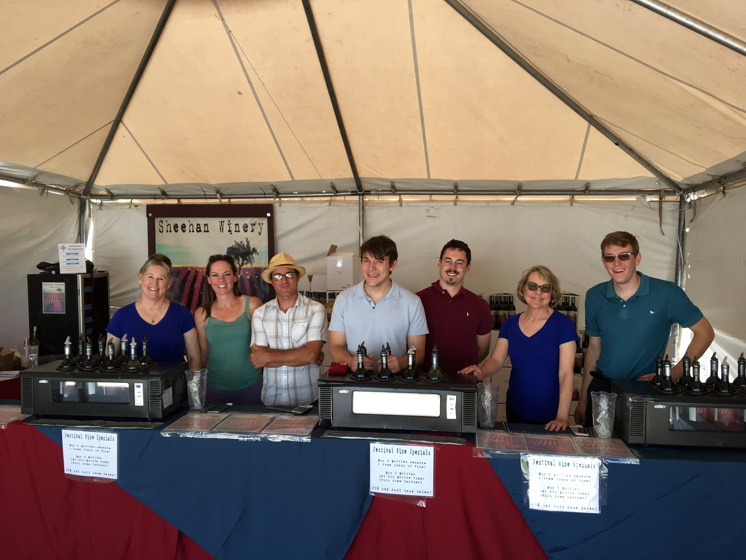 The crew snaps a photo before the crowds arrive at the Las Cruces Wine Festival 2017