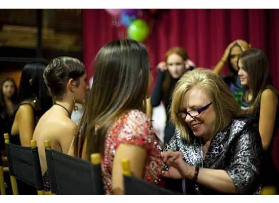 Owner, Kathie, putting her final touch on fittings at Fashion Week of Rochester 2012