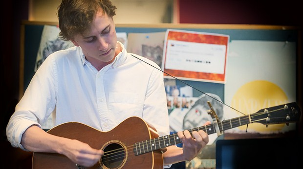 Dylan Menzie, pictured here performing in the CBC Music Toronto offices, is your brand new #1 on this week's R220. PHOTO (Cathy Irving/CBC Music)
