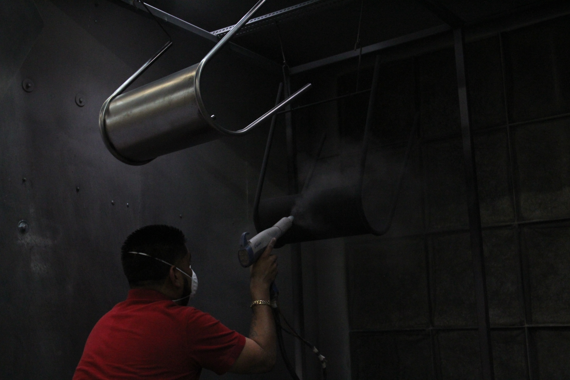 Eric from Express Coating spraying down the first coat of matte black.