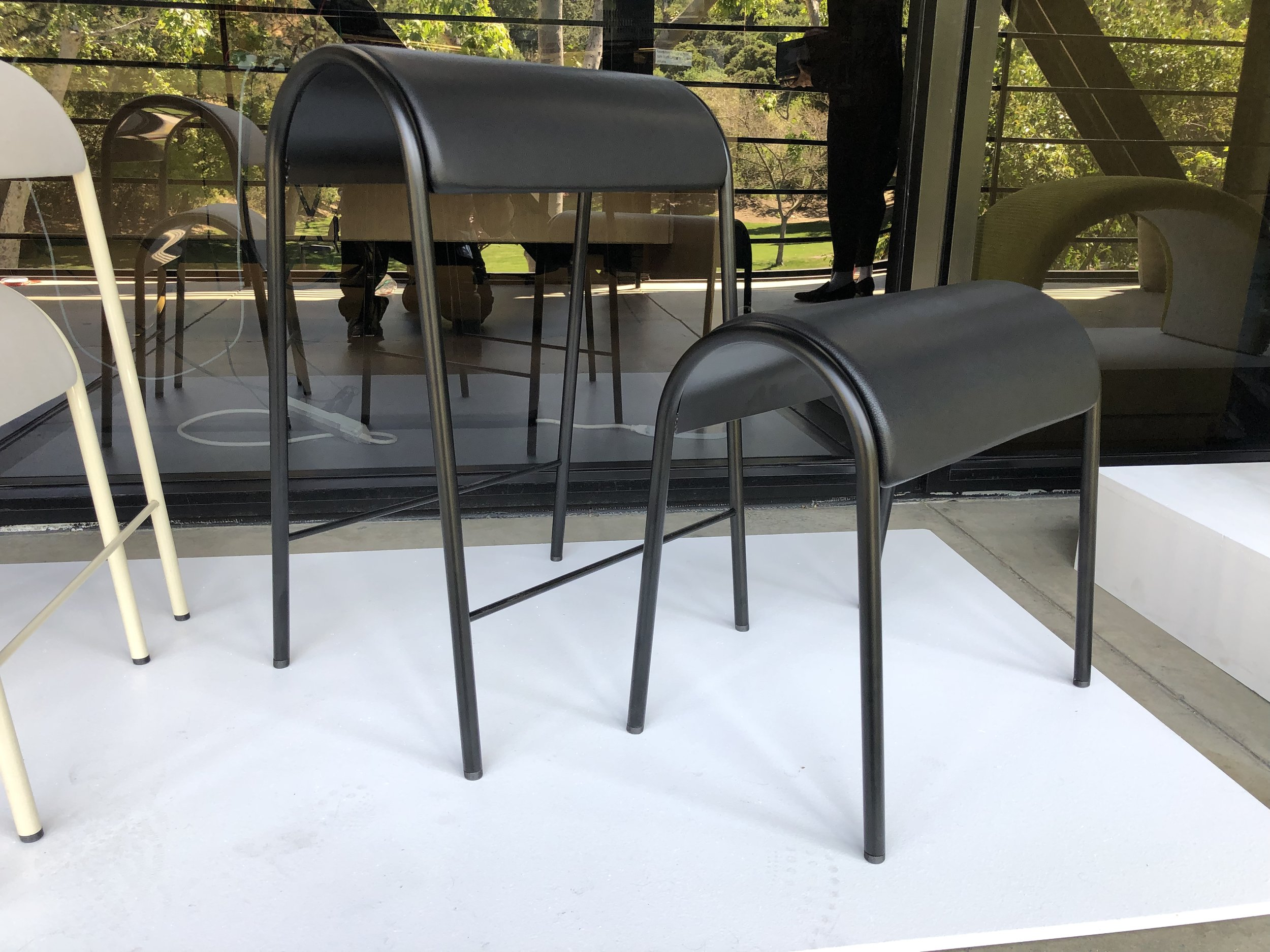Satin black metal frame, with black leather upholstery.