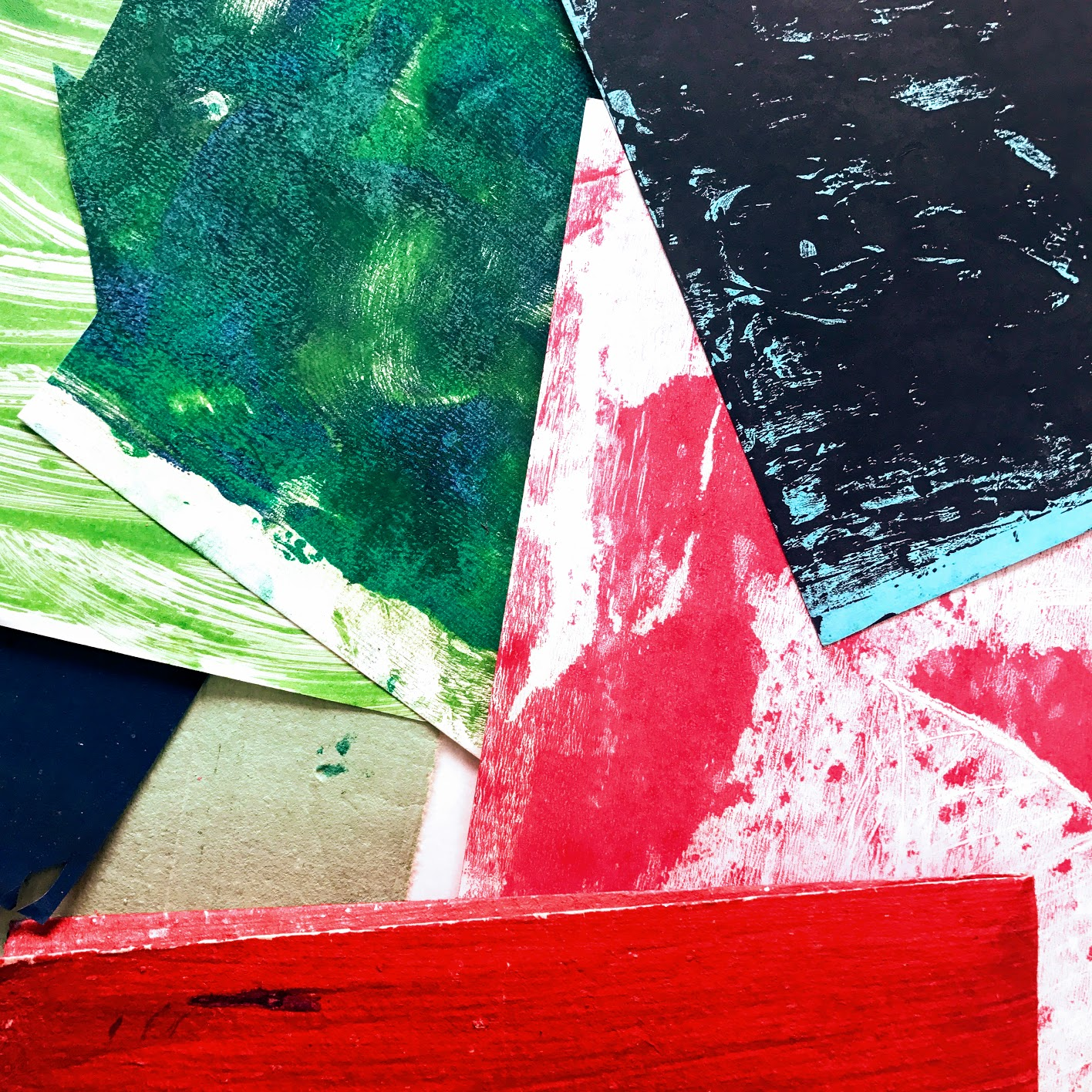 Creating textures with acrylic paints, ink and craft papers.