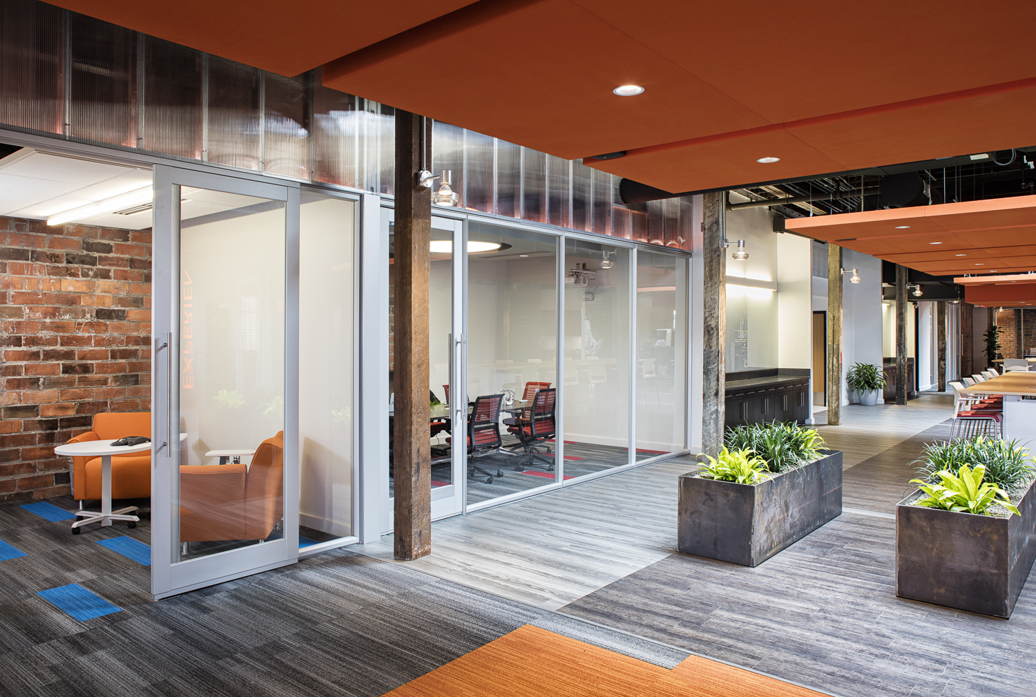 Acoustically treated private workspaces in the Forge office.
