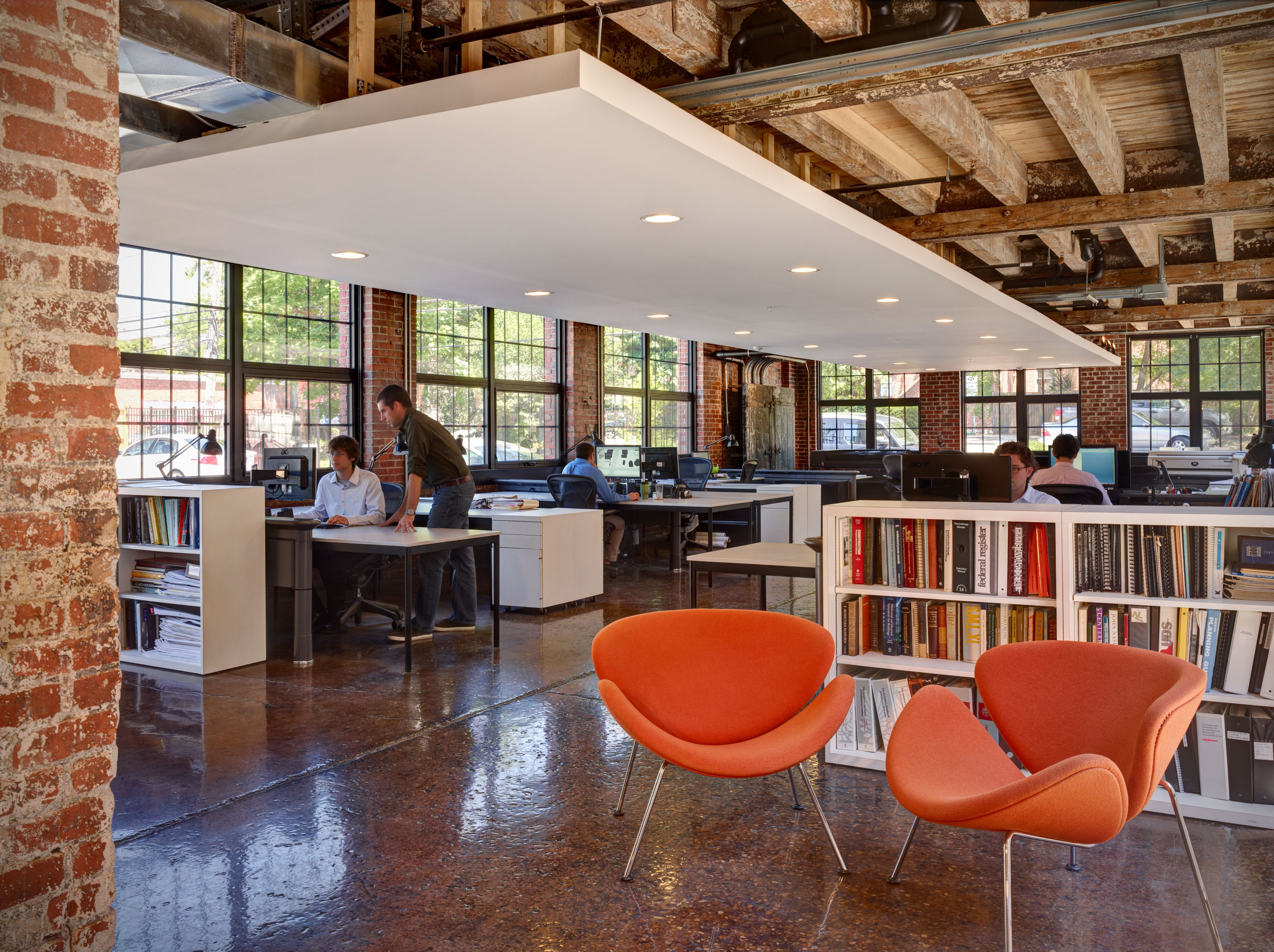 Large windows surround the workspaces at the WSA Studio office.