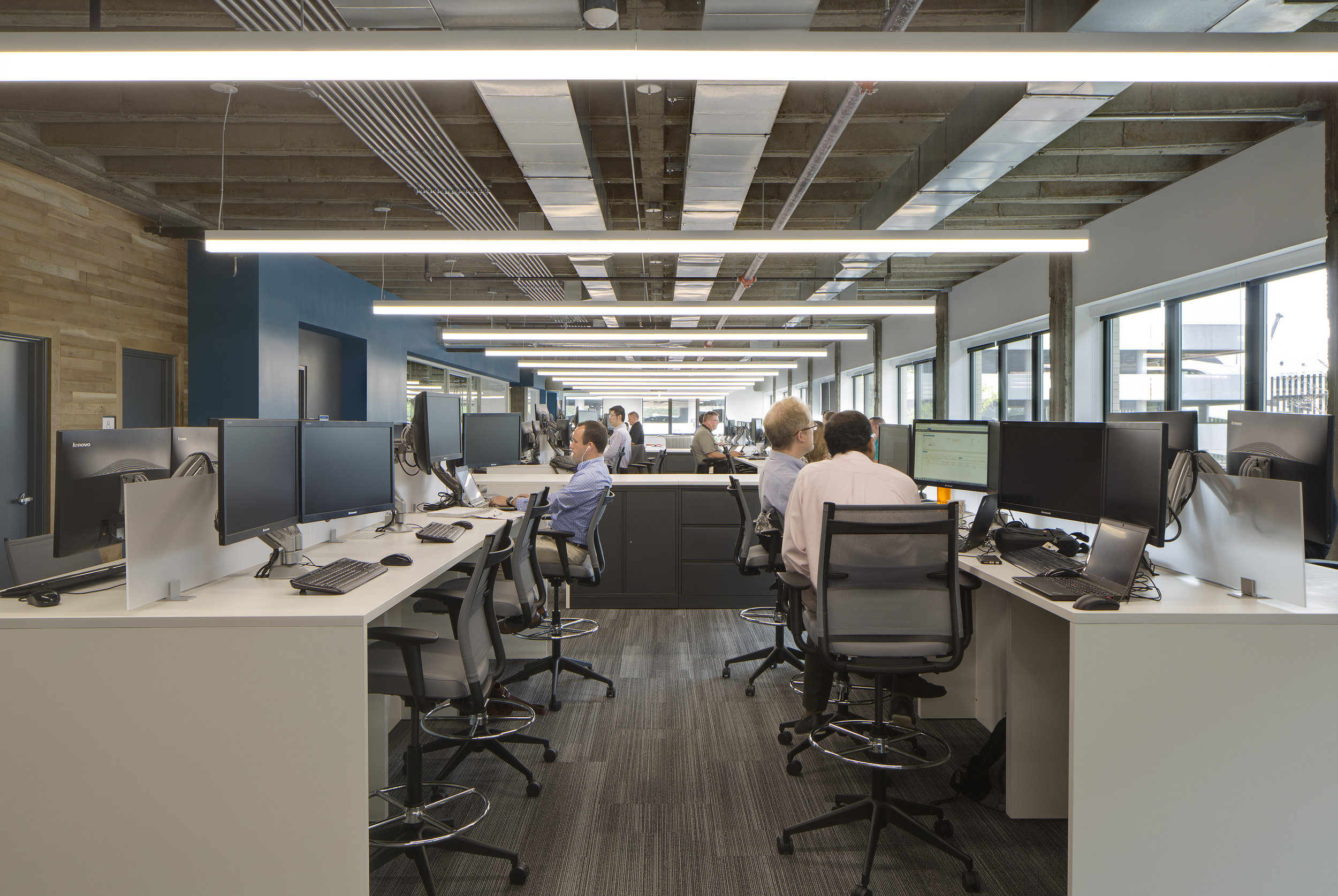 Open office floor plans can break down the barriers of workplace hierarchy.