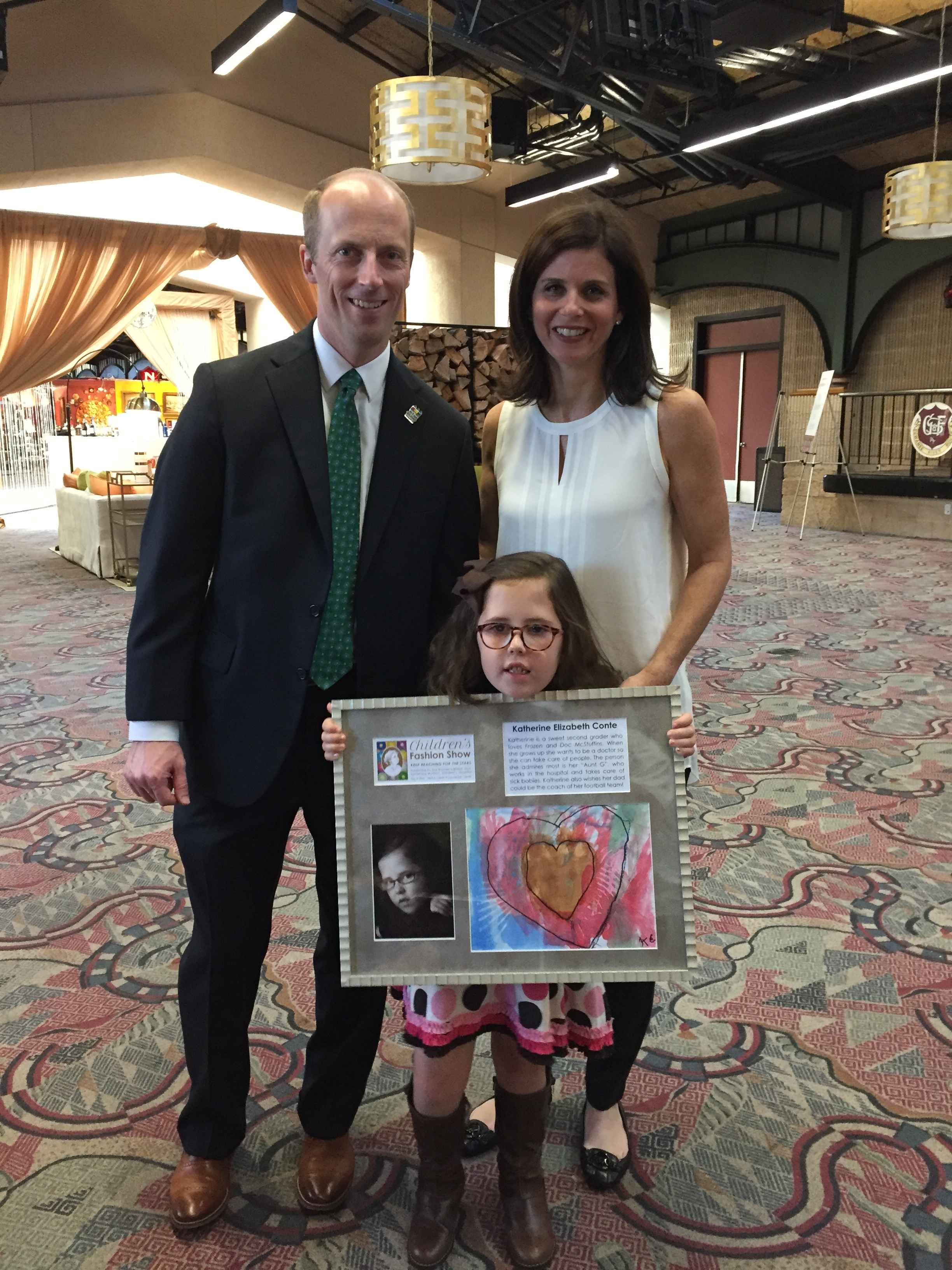 Kate with Wolfson Children's Hospital Children's Fashion Show sponsors Justin and Paige Terry.