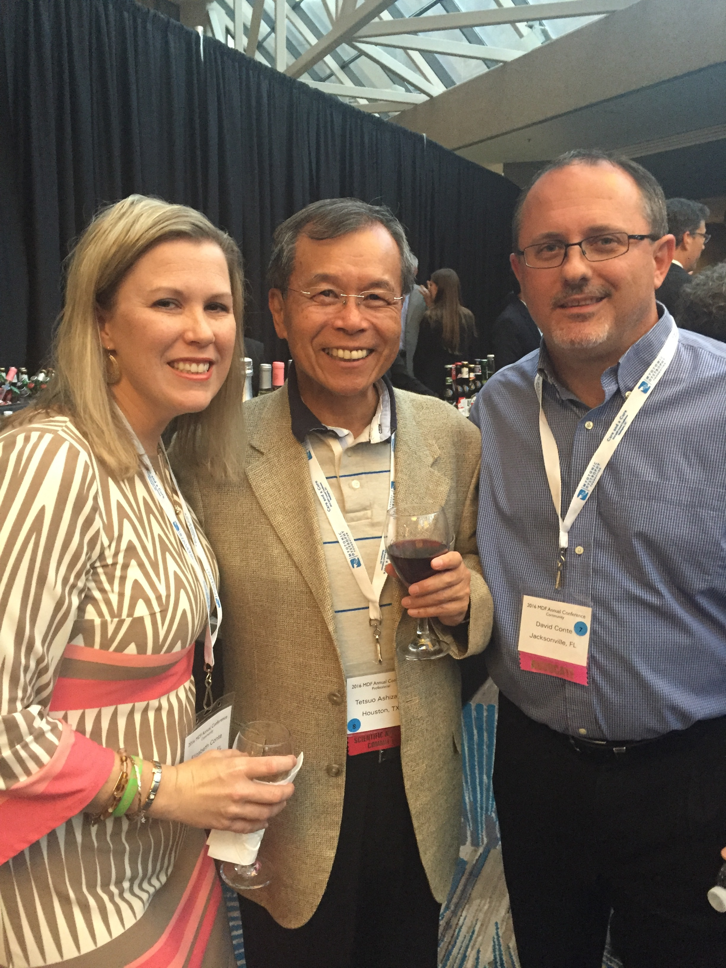 David and Elizabeth with Dr. Tetsuo Ashizawa at the Annual MDF Conference.