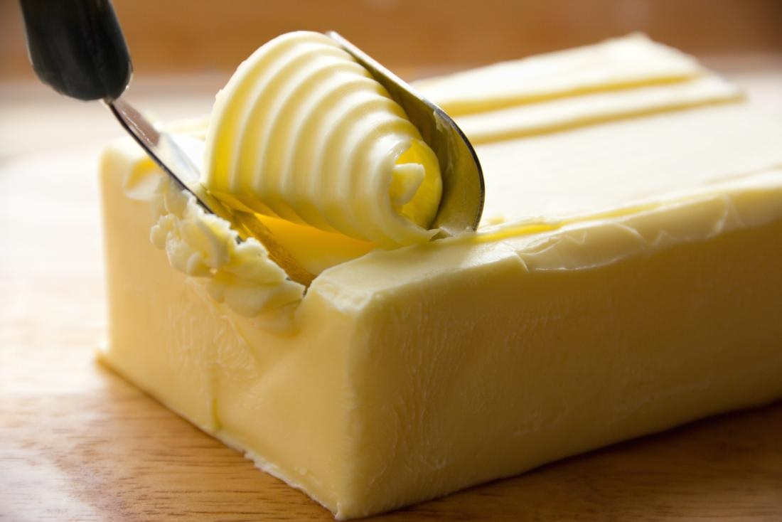 close-up-of-block-of-butter-being-sliced-may-raise-cholesterol.jpg