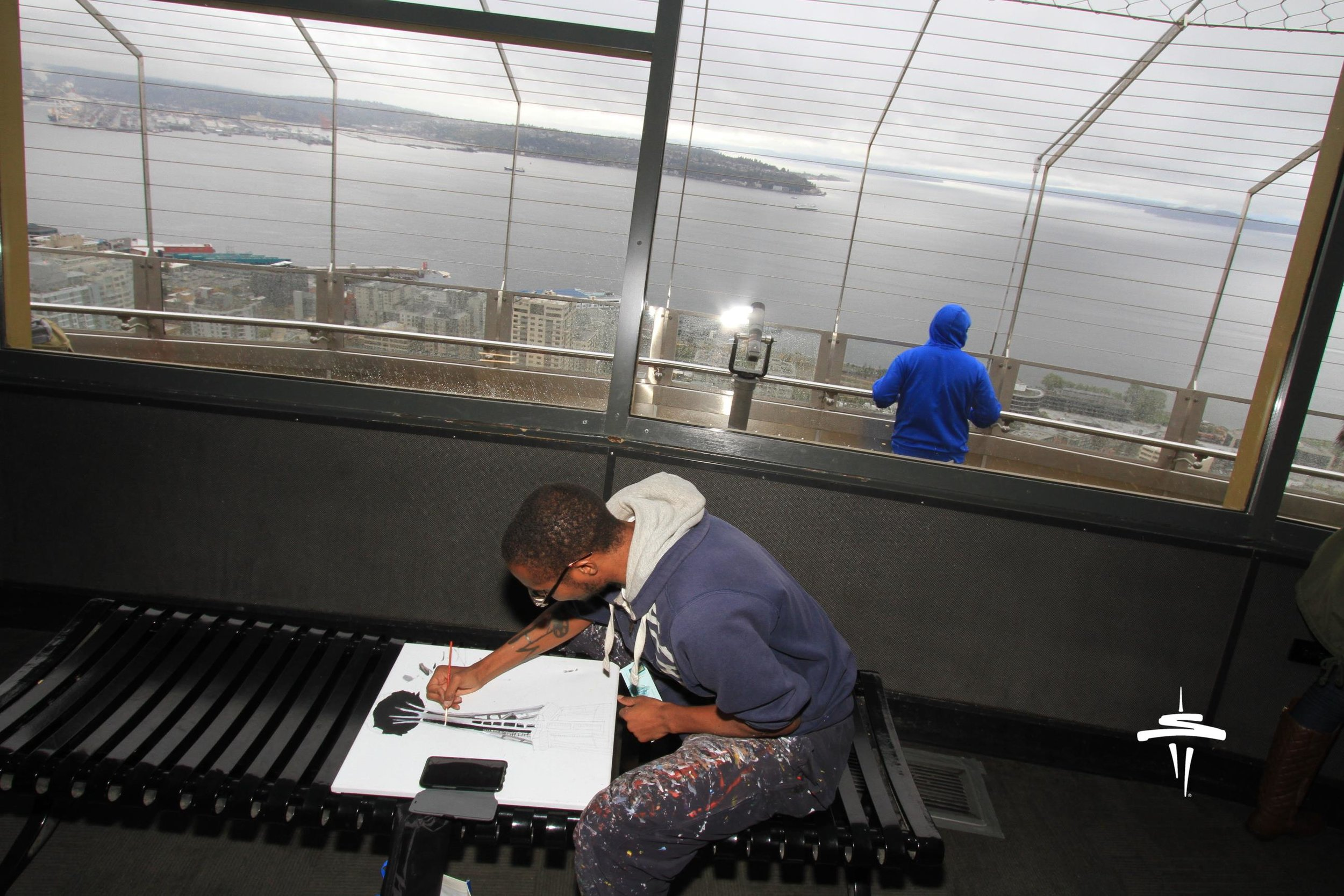 My professional photography photoshoot of the live painting Space Needle I'm doing in the picture that a photographer employee took of me while working.