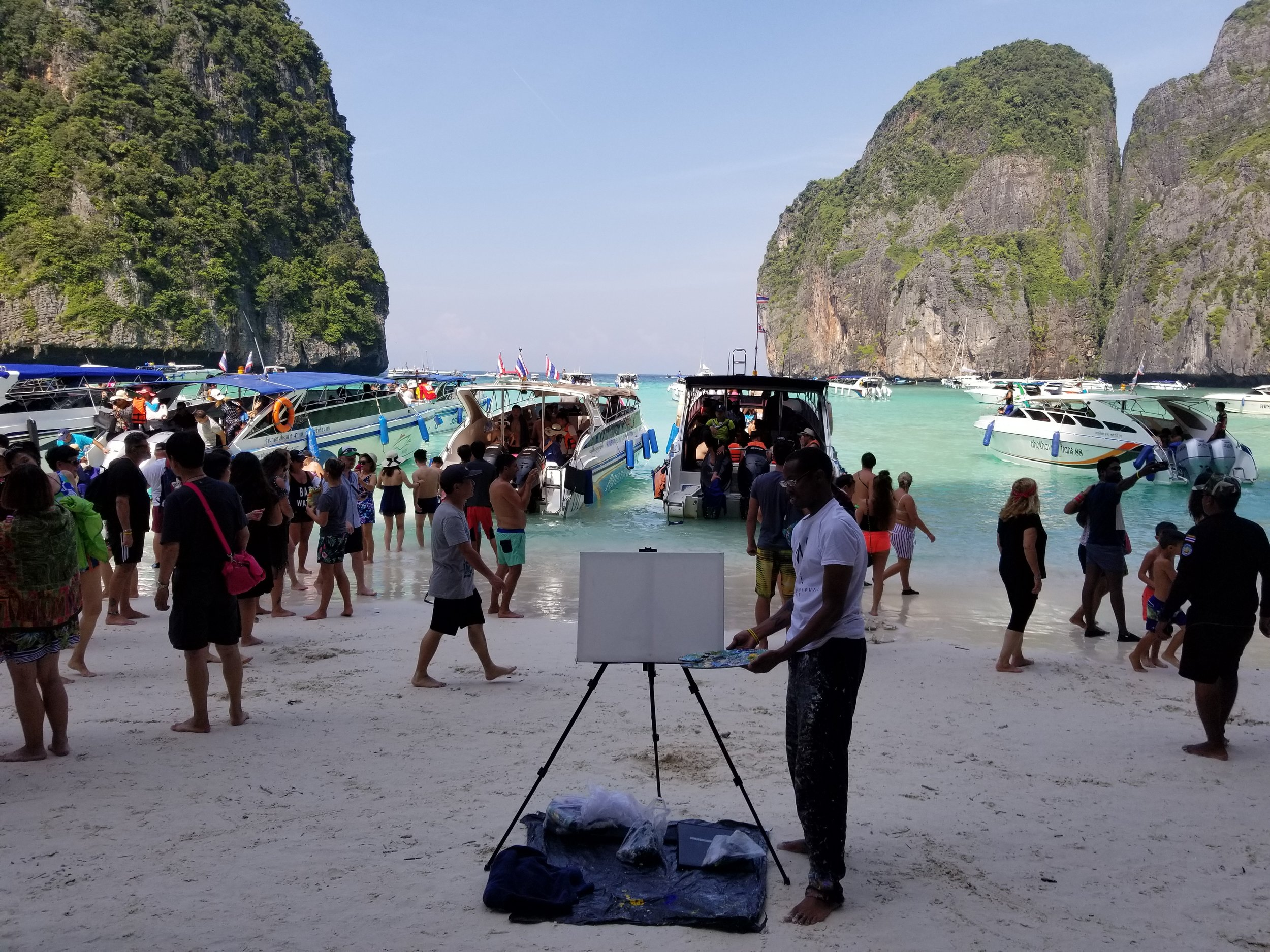 Me at my live painting show event on the beach at Maya Bay in Phi Phi Islands.
