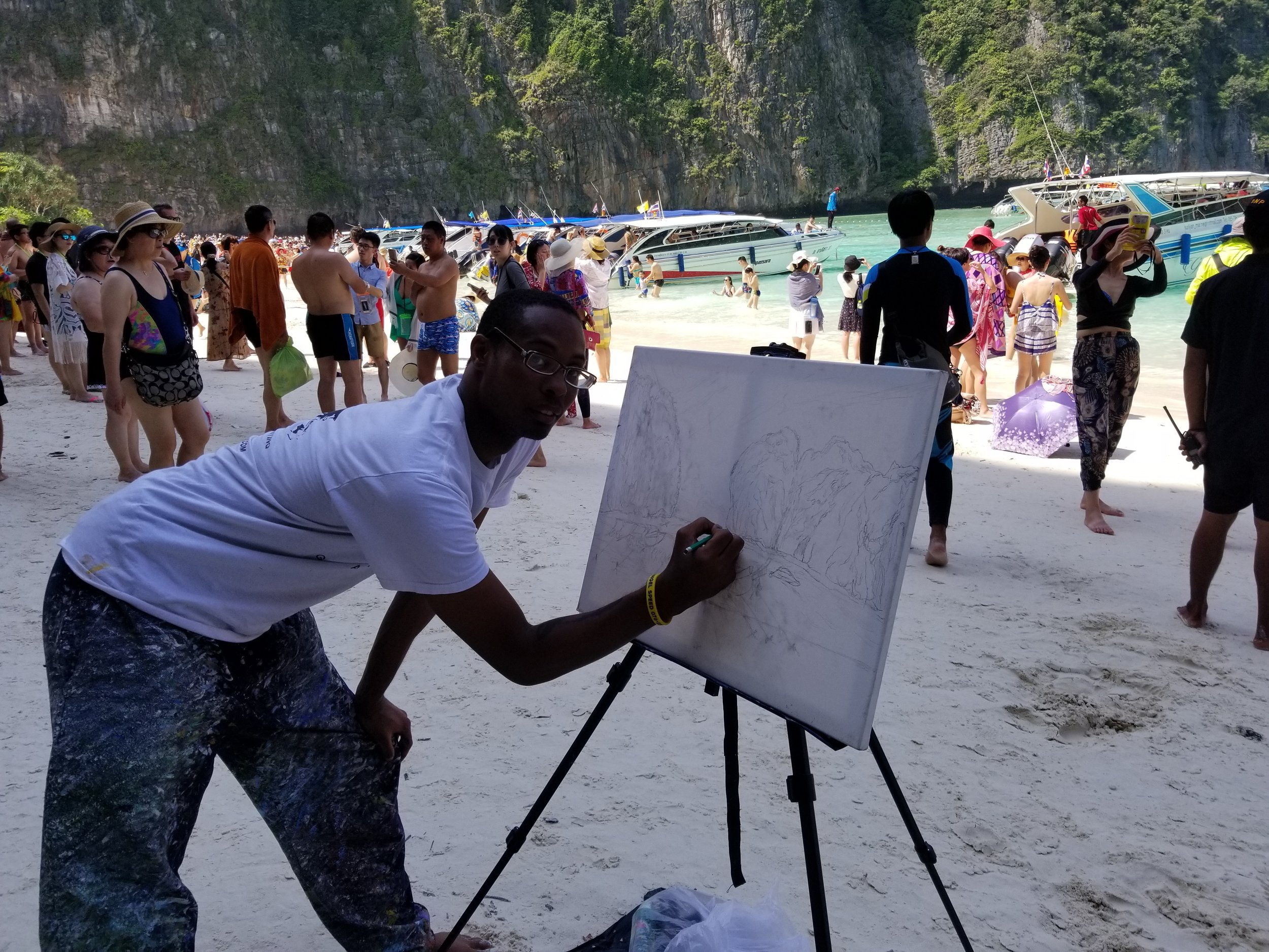 Me sketching out my painting of the Maya Beach Phi Phi Island on a canvas.