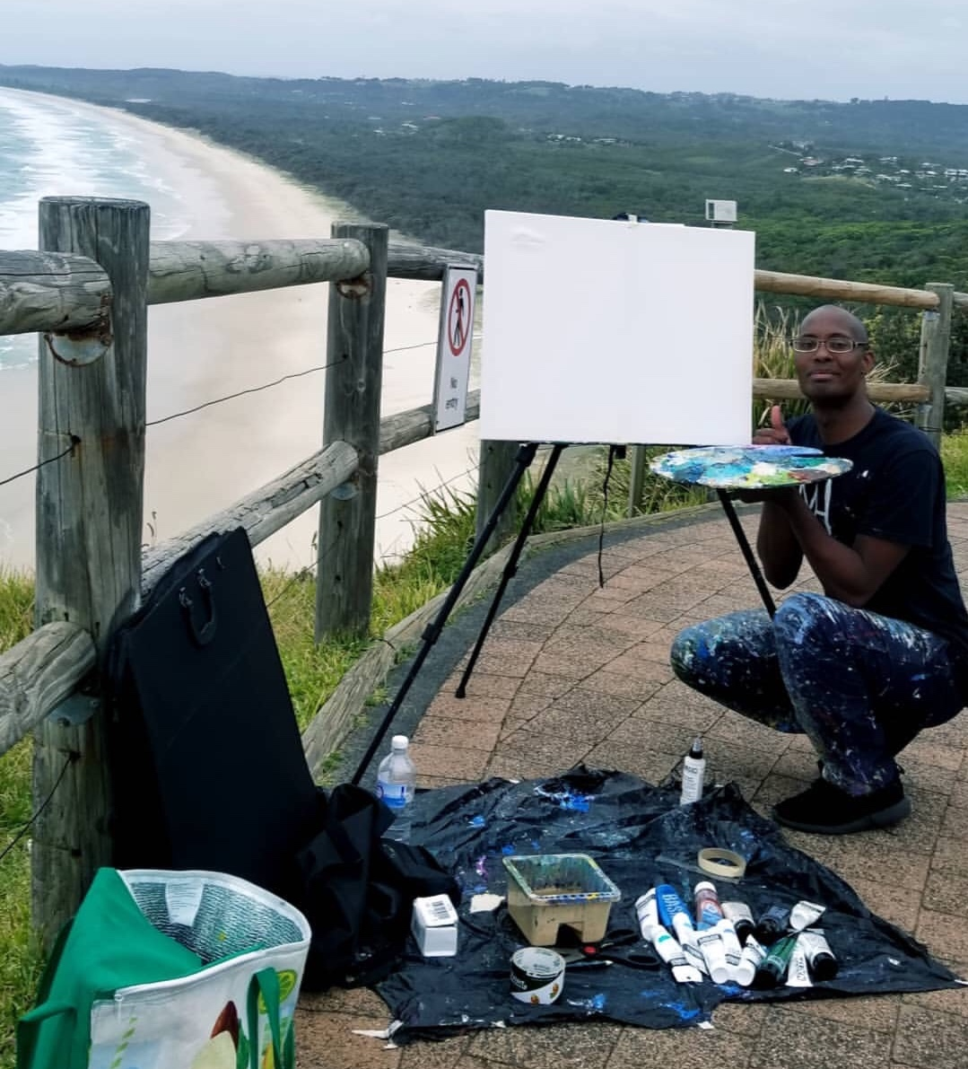 Me setting up my display art project at Byron Bay Cape conversation view/Tallow Beach in Byron Bay, NSW.