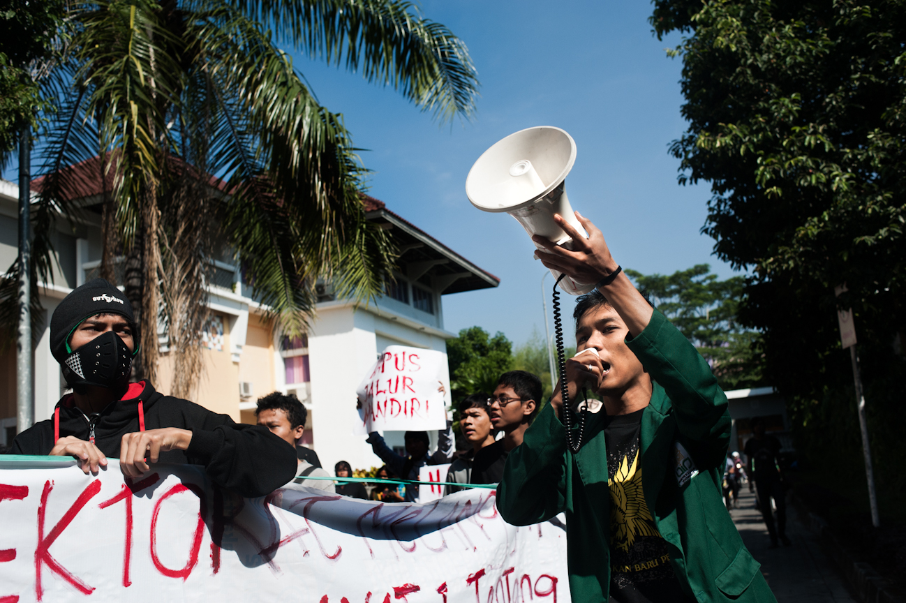 Okky leads the National Anthem of Indonesia during the peaceful demonstration against new school legislation at Universitas Islam Negeri.