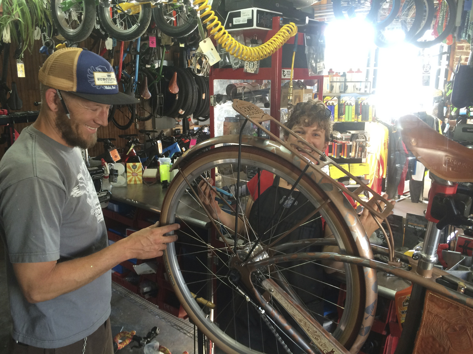 Jason and Claire at Subculture Cyclery helping fine tune the bike.