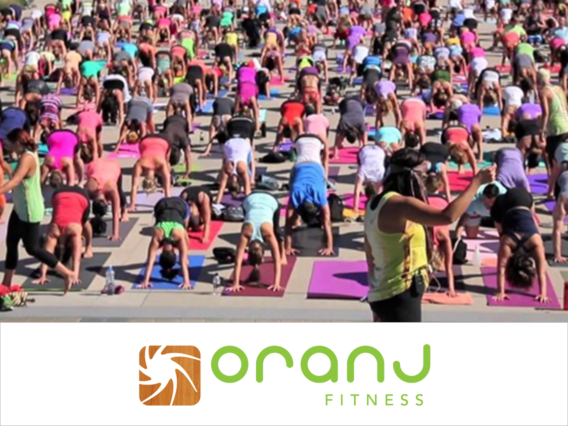 InTheNews_The-Daily-Courier-Largest-Outdoor-yoga.jpg