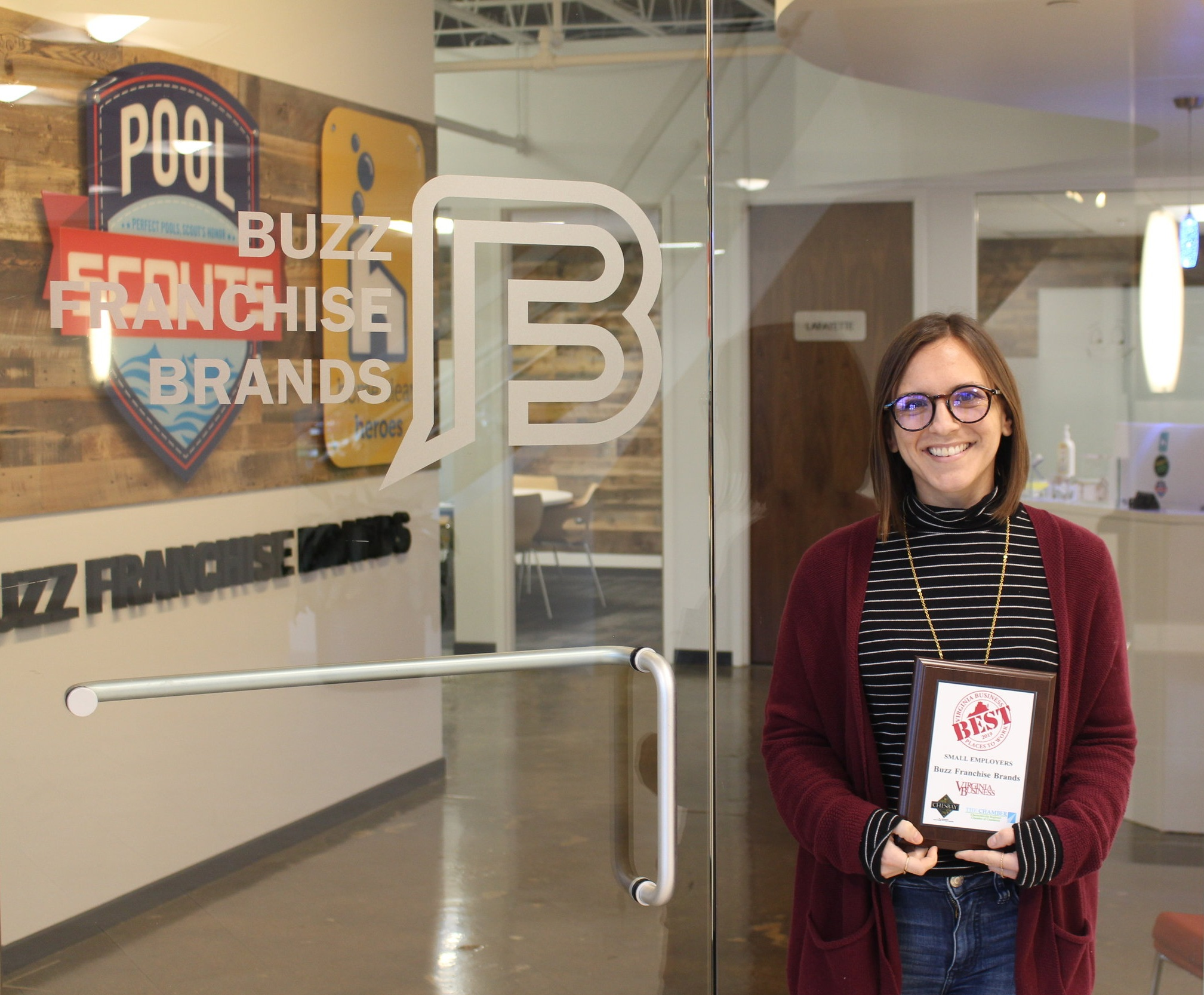 BFB Employee Cait Holding Best Place to Work Award