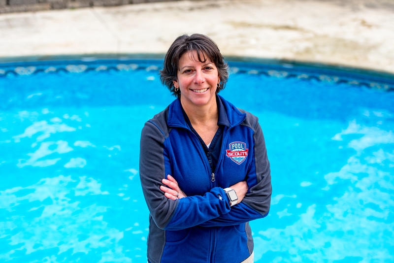 Pool Scouts owner Tiffiny Consol in front of pool with arms crossedi.jpg