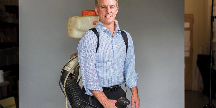 Brian Garrison holding Mosquito Joe sprayer.jpeg