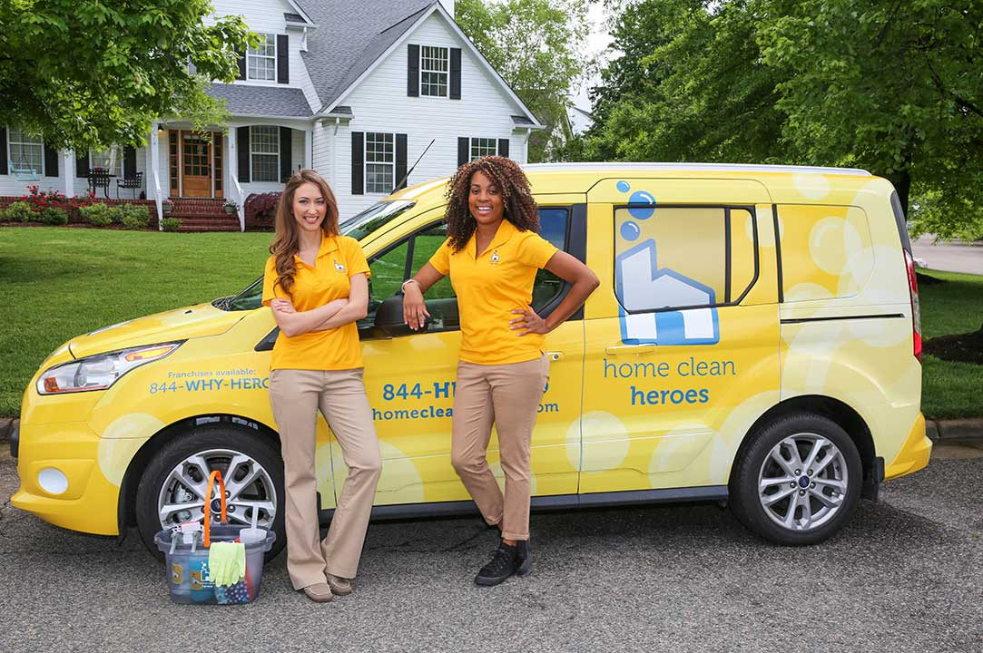Two Home Clean Heroes cleaners standing in front of a Home Clean Heroes car