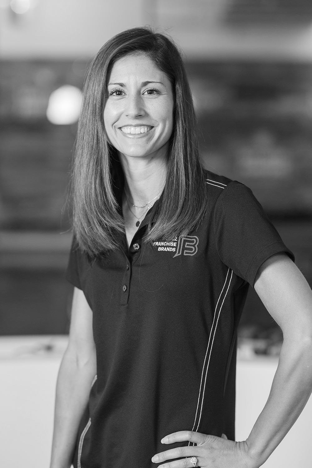 Black and white image of Angela Paules, CMO