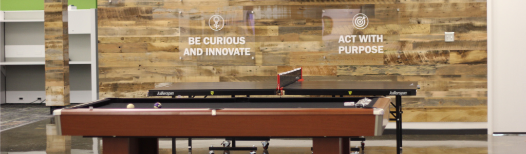 Buzz Franchise Brands Office Space - pool table & values wall