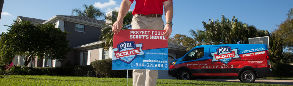Pool Scouts technician in front of house, putting out yard sign, by Pool Scouts van