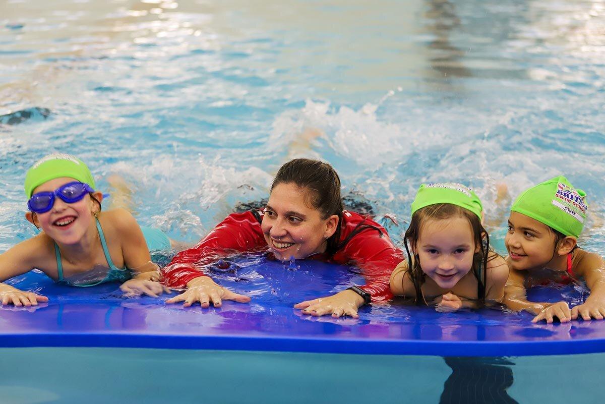 Director of Aquatics Melissa teaching children how to swim