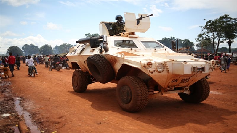A UN armoured vehicle patrols a road near the town of Bria, which saw heavy fighting this week [Cassandra Vinograd/Al Jazeera]