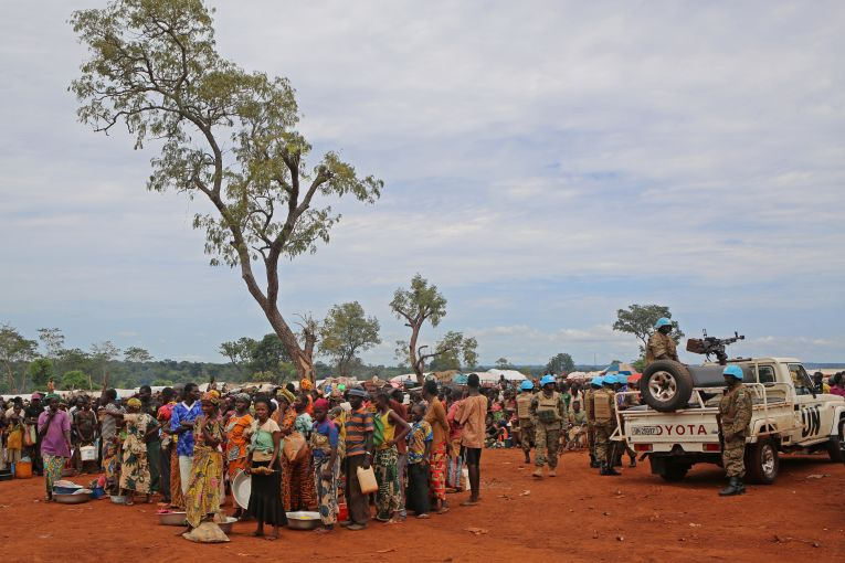 Displaced people wait for rations in Bria, Central African Republic, on Sept. 26. (Cassandra Vinograd/The Washington Post)