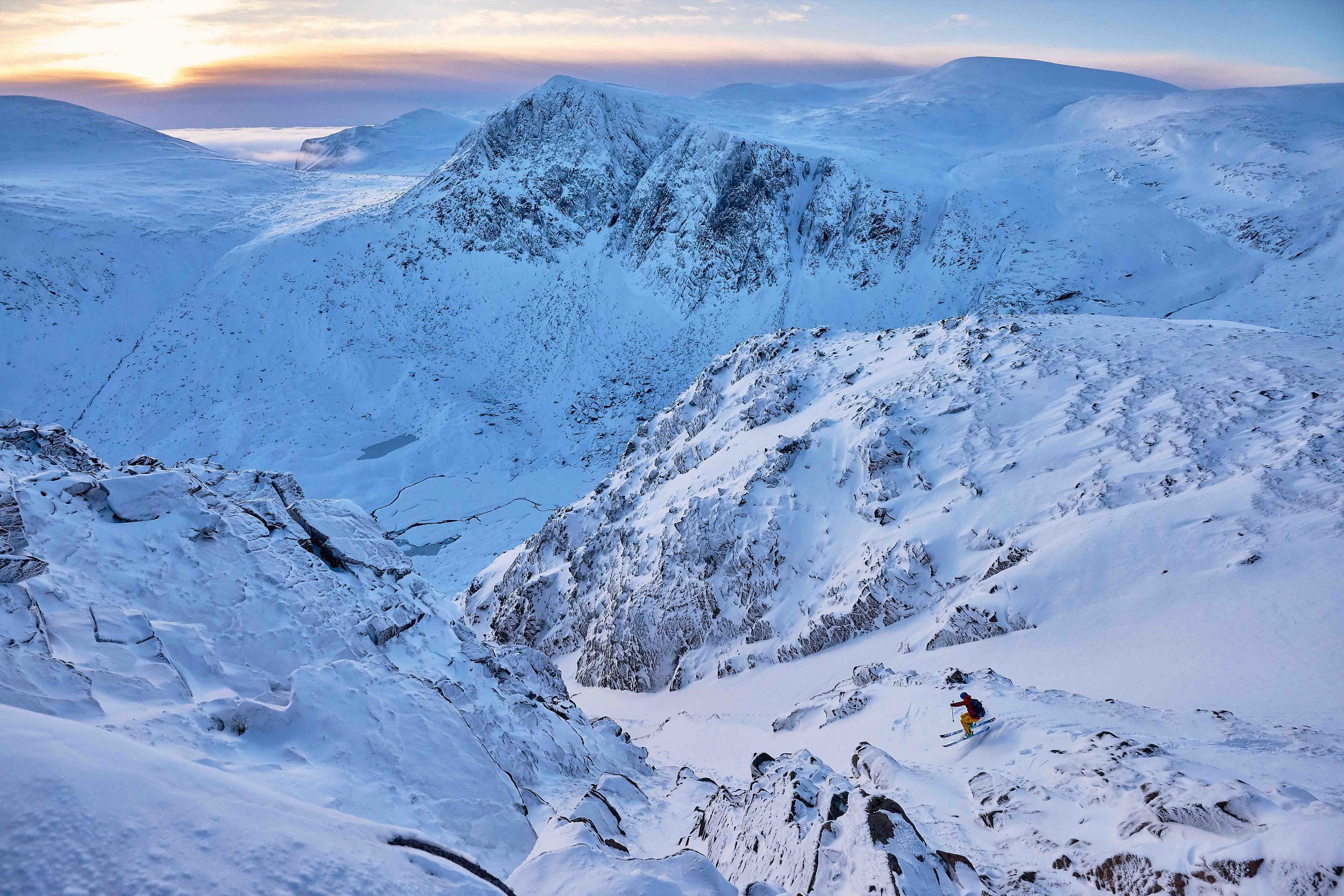 Pete Mackenzie dropping into Diagonal Gully as the sun rises over the Cairngorms