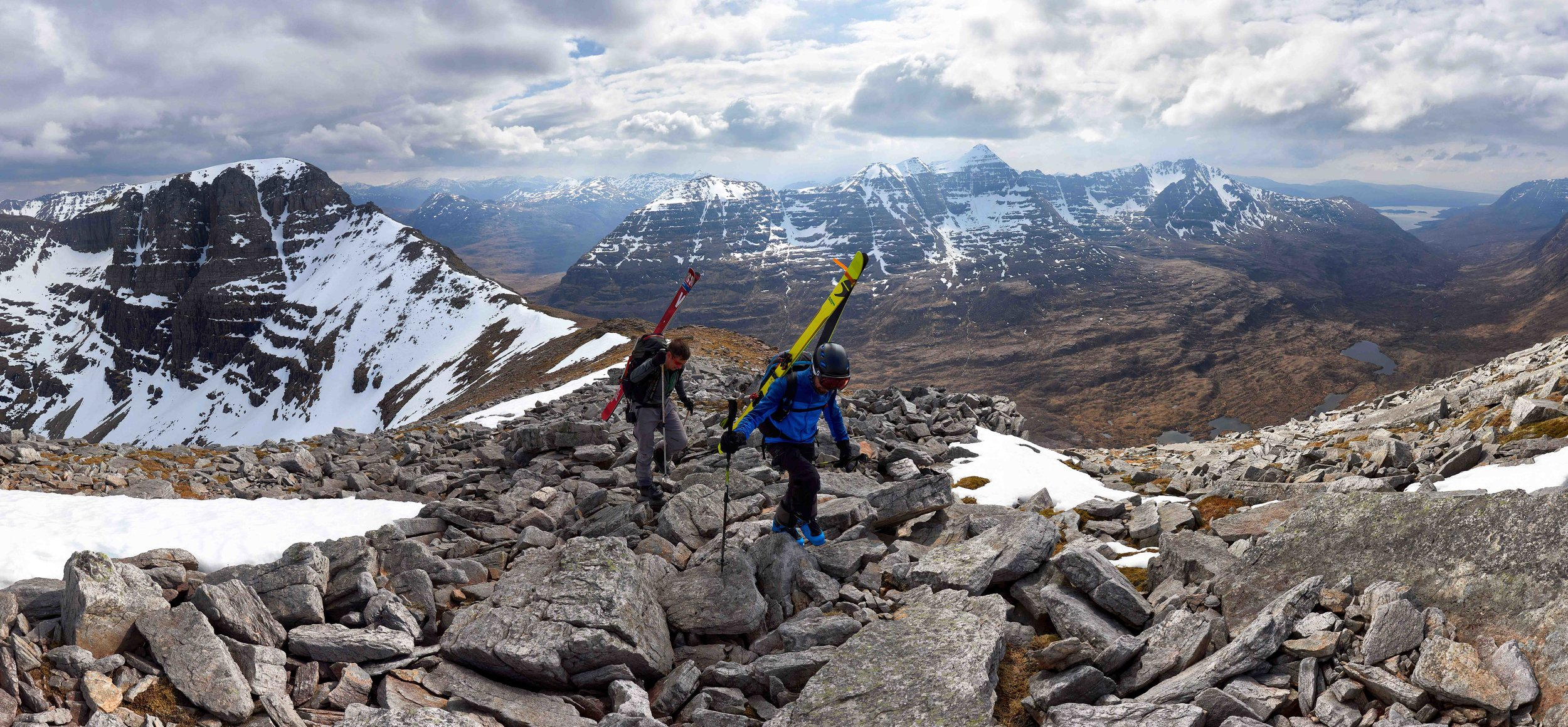 Hiking towards Sail Mhor and Morrisons Gully, with views of Beinn Eighe's Triple Buttress, Fuselage Gully (the complete line running down the lookers right side of the buttress) and Liathach stretched out behind.