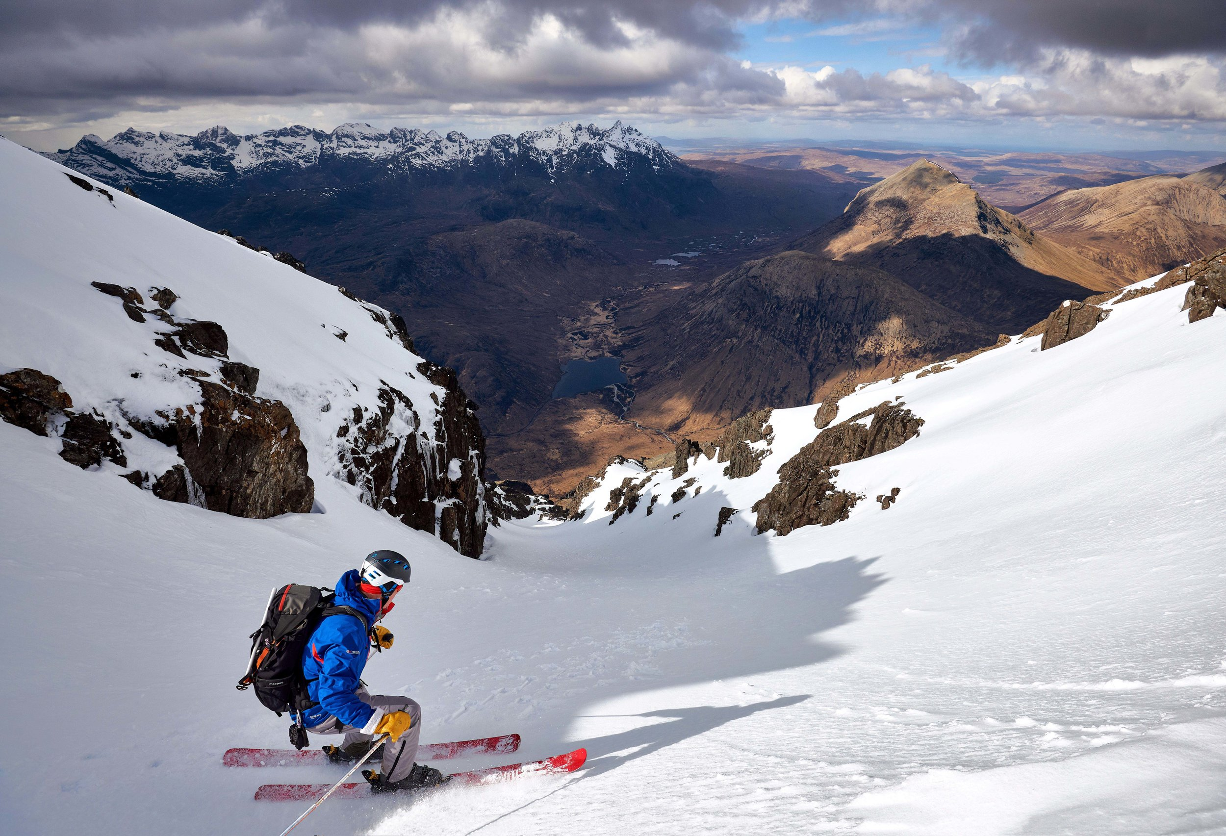 Skiing off the col into the stunningly situated Willink's Gully, a superbly situated line running down the west side of the mountain offering some impressive views out to Sgùrr nan Gillean and the northern half of the Cuillin ridge.