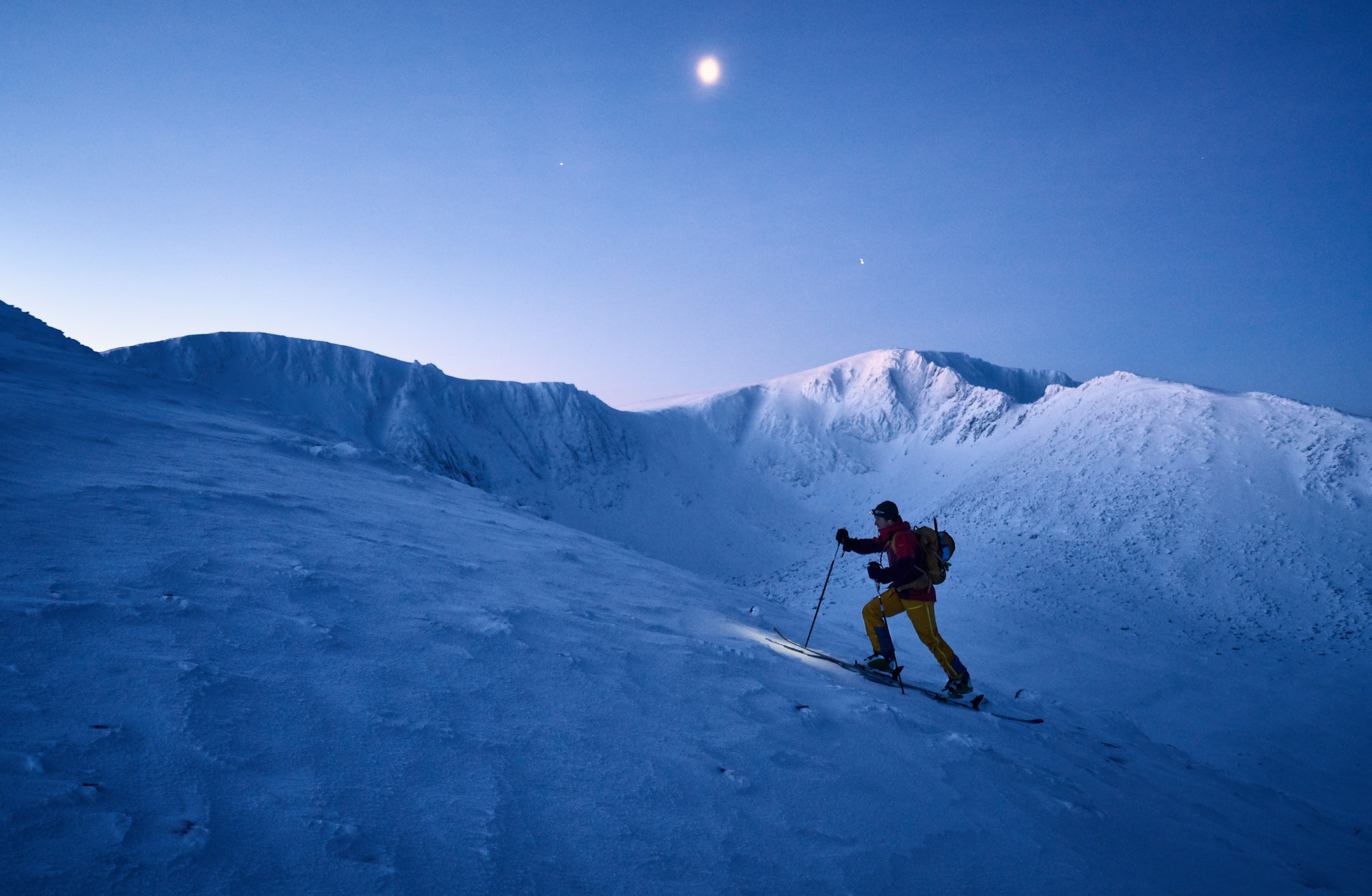 One of several very early morning starts during the making of the film. Pete skinning up past Coire an t-Sneachda as first light begins to glance the top of the Cairngorm plateau.