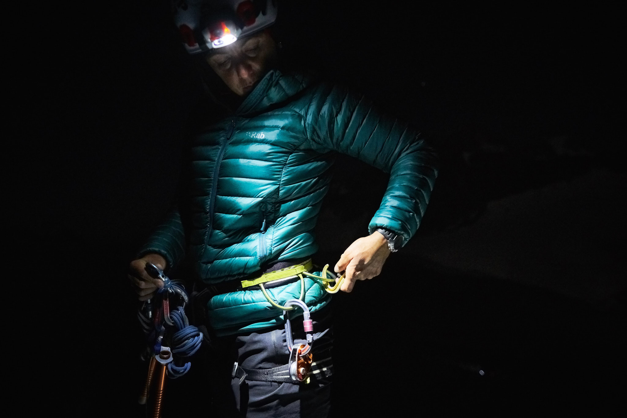 Mountain guide, Julia Virat, gearing up at the foot of the Aiguille d'Entrèves