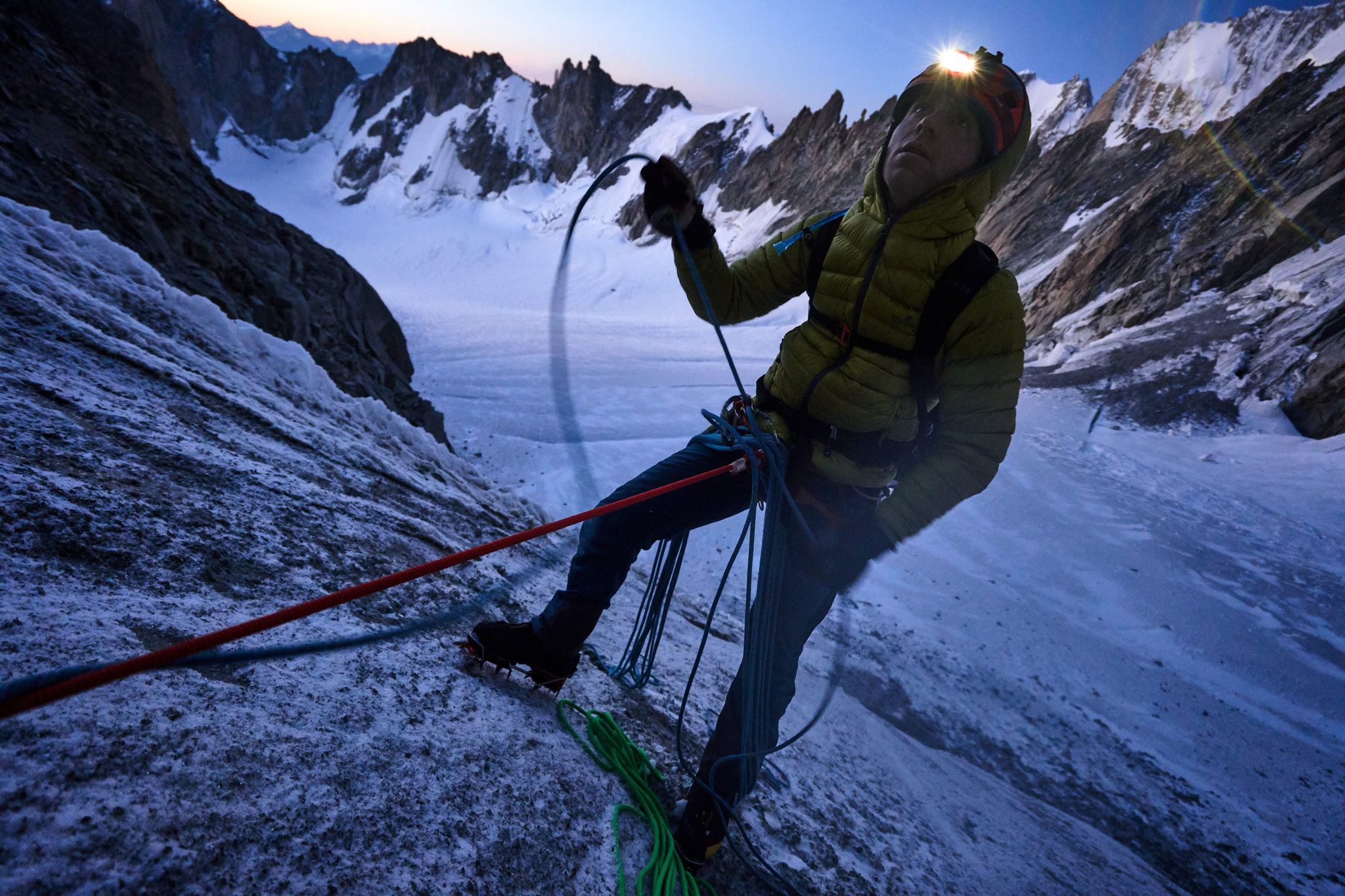 Willis belaying half way up the bulletproof ice slope at the foot of the Diables Arête