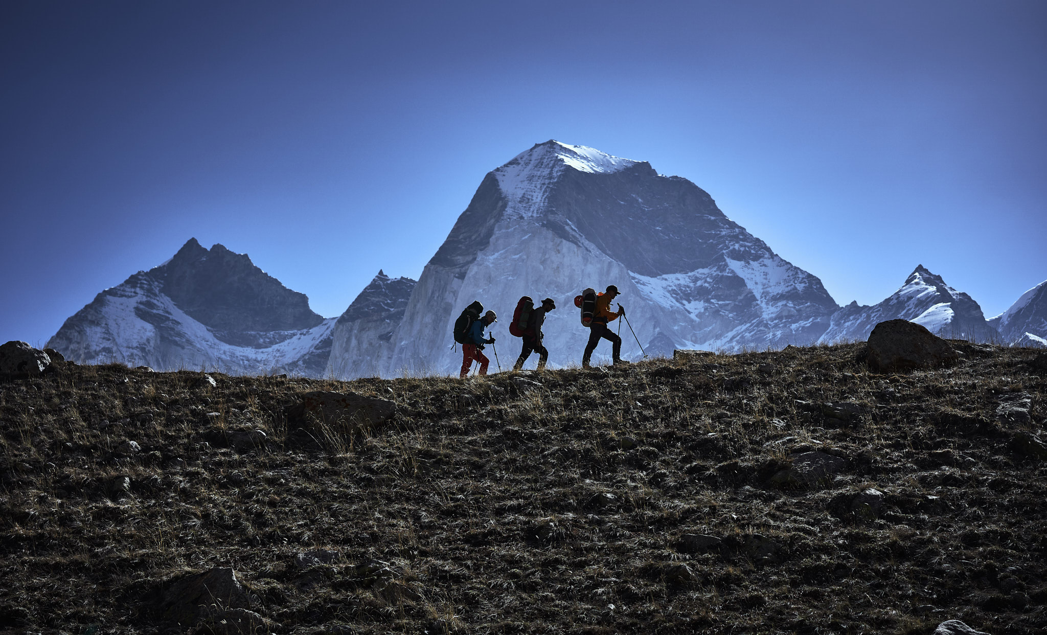 The team leaves basecamp to begin the two day trek to advanced basecamp.  The three Bhagirathi's can be seen behind.