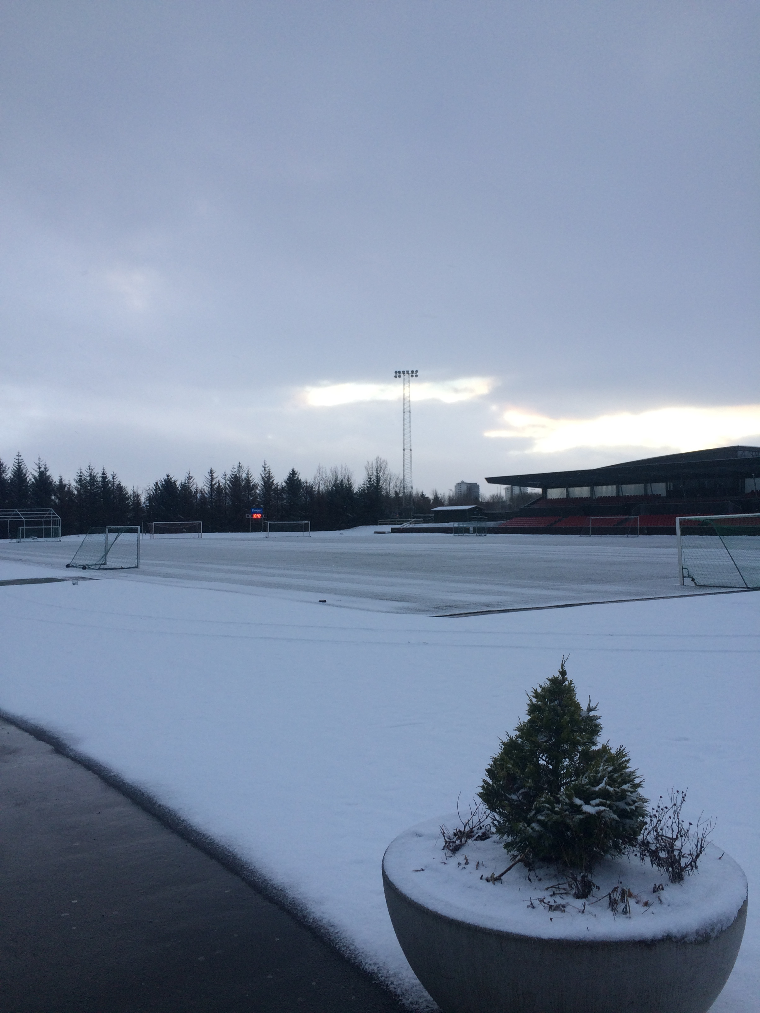 Players have to shovel off the snow before they can train at Valbjarnarvöllur